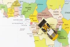 Bulldozer on map Royalty Free Stock Image