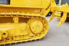 Bulldozer met schulpzaag Stock Foto's
