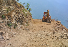 Bulldozer on mountain road Stock Images