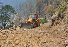 Bulldozer on mountain road Stock Image