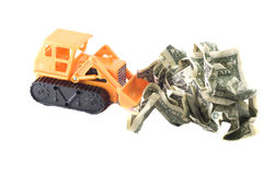 Bulldozer moving money Stock Images