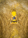 The bulldozer on muddy terrain. Royalty Free Stock Image