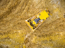 The bulldozer on muddy terrain. Stock Photography
