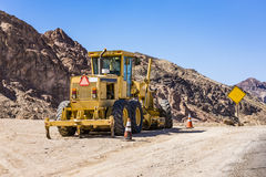 Bulldozer on narrow road. Called Artists drive in Death valley Royalty Free Stock Photo