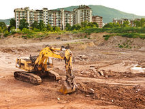 Bulldozer near city Royalty Free Stock Photo