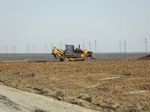 Bulldozer nel deserto Immagini Stock Libere da Diritti