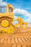 Bulldozer ob sand rear vie with background sky Stock Images