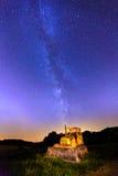 Bulldozer och Vintergatan Arkivfoto