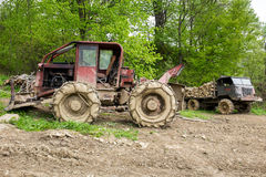 Bulldozer and old truck in a forest Royalty Free Stock Images