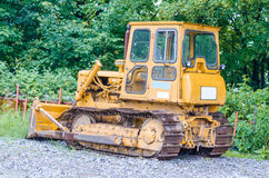 Bulldozer, Olttimer, tracked vehicle. VELBERT, GERMANY - MAY 29.2014: On an old factory site in the city of Velbert in NRW is this old tracked vehicle Stock Photography