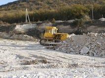 Bulldozer op bouwwerf stock afbeeldingen