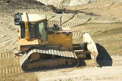 Bulldozer op bouwwerf stock foto