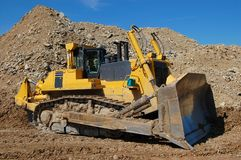 Bulldozer in open pit Royalty Free Stock Photos