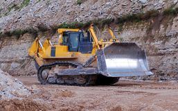 Bulldozer in open pit. Heavy bulldozer in open cast mining quarry Stock Photo