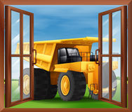 A bulldozer outside the window Royalty Free Stock Photo