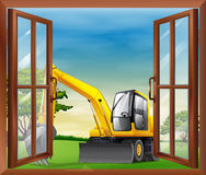 A bulldozer outside the window Royalty Free Stock Photography