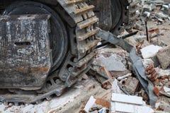 Bulldozer over rubbish Royalty Free Stock Image