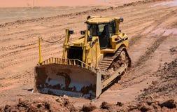 Bulldozer på arbete på plats Arkivfoto
