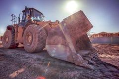 Bulldozer på konstruktionsplats Royaltyfria Bilder