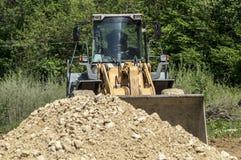 Bulldozer på konstruktionsplats Arkivbild