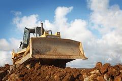 Bulldozer på konstruktionsplatsen Arkivbilder