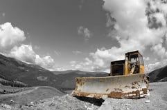 Bulldozer in Parang Mountains, landmark attraction in Romania. Bulldozer. The battle between man and nature in Parang Mountains, landmark attraction in Romania royalty free stock photos