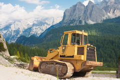 Bulldozer in the picturesque scenery Stock Photos