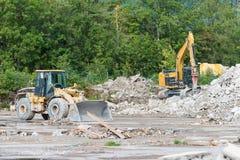 Bulldozer and pneumatic jackhammer digger Stock Photos
