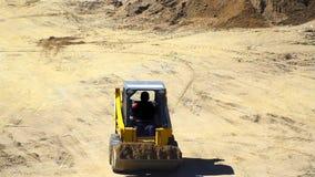 A bulldozer pushing dirt