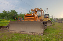 Bulldozer on railway Royalty Free Stock Photography