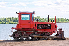 Bulldozer red by the river Royalty Free Stock Images