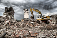 Bulldozer removes the debris from demolition of derelict buildings Royalty Free Stock Photo