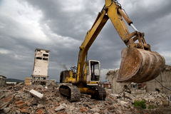 Bulldozer removes the debris from demolition of derelict buildings Stock Photography