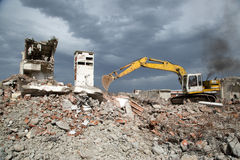Bulldozer removes the debris from demolition of derelict buildings. Bulldozer removes the debris from demolition of old derelict buildings Royalty Free Stock Photography