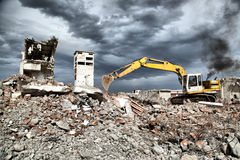 Bulldozer removes the debris from demolition of derelict buildings Stock Images