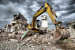 Bulldozer removes the debris from demolition of derelict buildings Royalty Free Stock Photos
