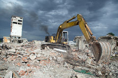 Bulldozer removes the debris from demolition of derelict buildings Royalty Free Stock Image