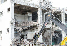 Bulldozer Removes the Debris From Demolition of Old Derelict Buildings on the Construction Site Royalty Free Stock Photos