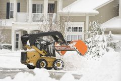 Bulldozer removing snow Royalty Free Stock Image