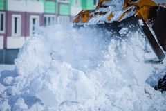 Bulldozer removing snow stock photography