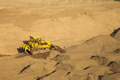 A bulldozer at a reservoir construction sit Royalty Free Stock Image