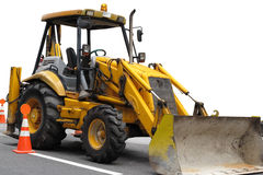 Bulldozer on road Stock Photo