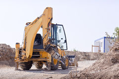 Bulldozer on road Stock Photography