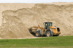 Bulldozer and sand Stock Images