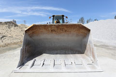 Bulldozer with sand mound Stock Images