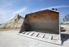Bulldozer with sand mound Royalty Free Stock Photo