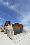 Bulldozer with sand mound Stock Photography