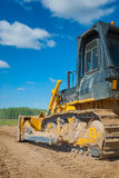 Bulldozer on sand view from back Royalty Free Stock Photos