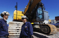 Bulldozer with site workers Royalty Free Stock Image
