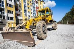Bulldozer som arbetar på konstruktionsplatsen Arkivfoto